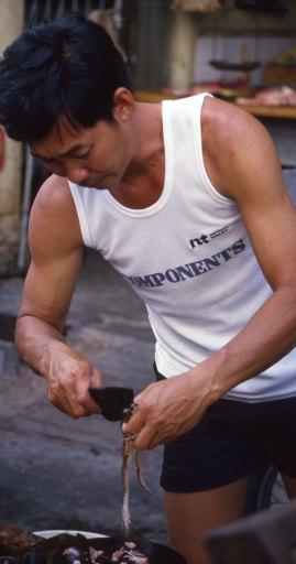 Malaysia 1989: street live-frog butcher