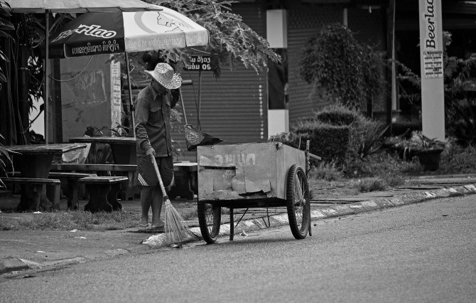 Vang Vieng, Laos, street sweeper