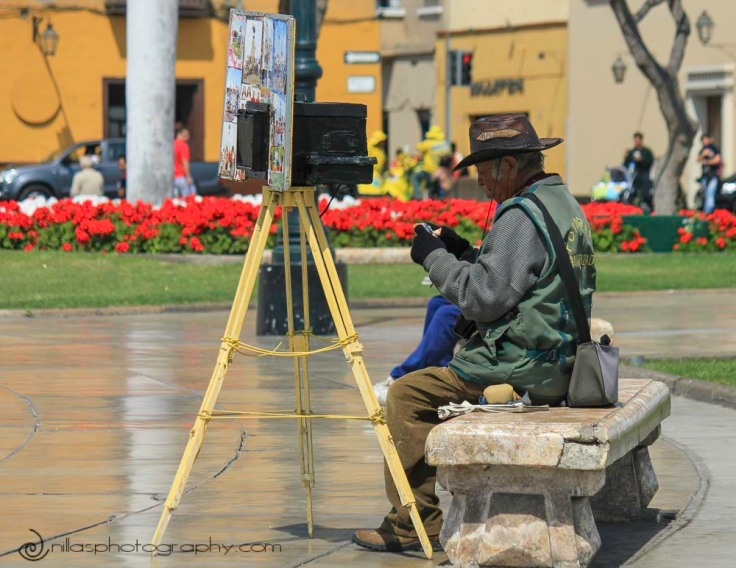 Photographer, Plaza de Armas, Trujillo, Peru, South America