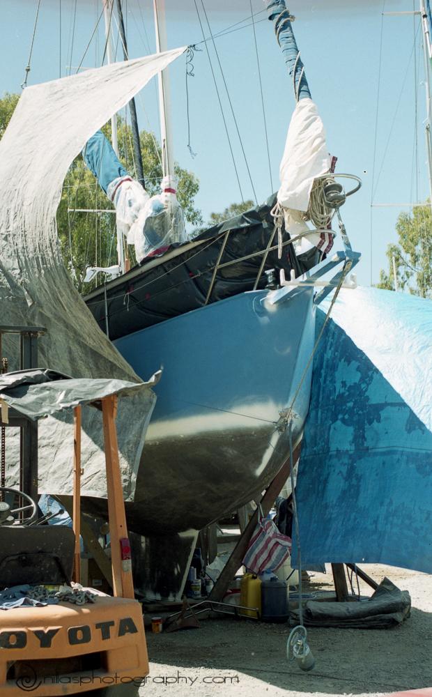 Sanding topsides a sailing boat, Brisbane, Queensland, Australia, Oceania
