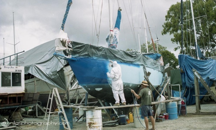 Spraying the topsides of a sailing boat, Brisbane, Queensland, Australia, Oceania