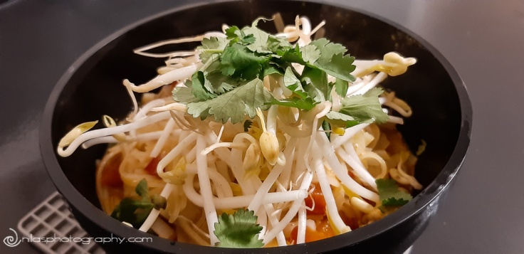 chicken and prawn spicy Laksa, topped with fresh Coriander, bean sprouts, and drizzles with fresh lime juice