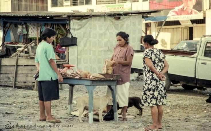Butcher in Parapat market, Sumatra, Indonesia, SE Asia