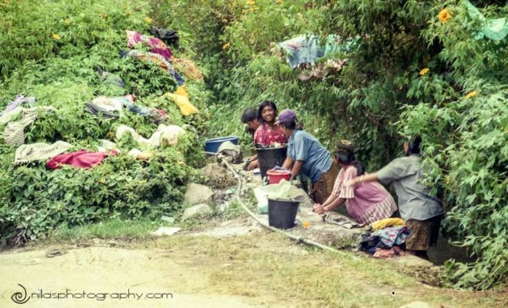 Locals doing laundry on roadside, Pulau Samosir, Lake Toba, Indonesia, SE Asia